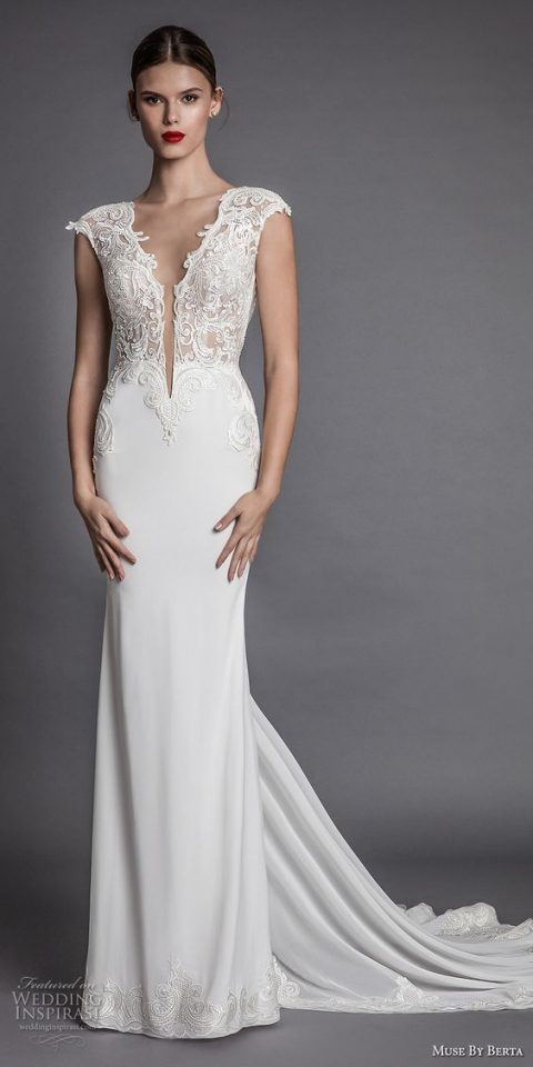 mermaid wedding dress with a lace bodice_ plunging neckline and a train
