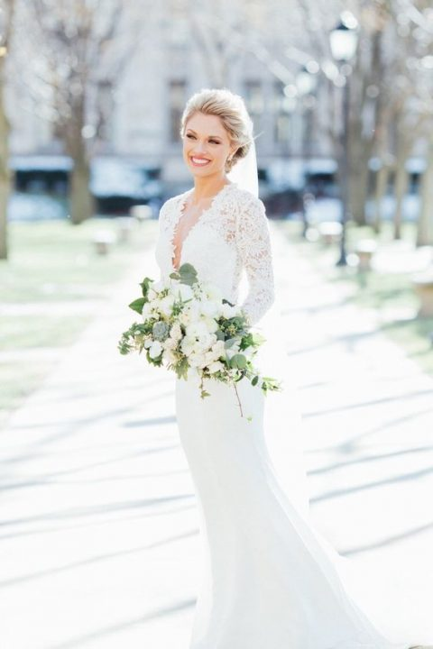mermaid wedding dress with a lace plunging neckline bodice and long sleeves