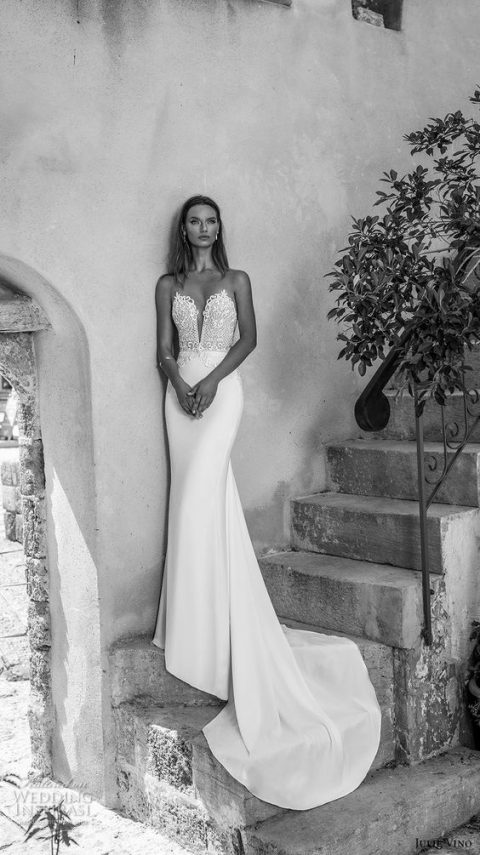 mermaid wedding dress with a plunging sweetheart neckline and a train