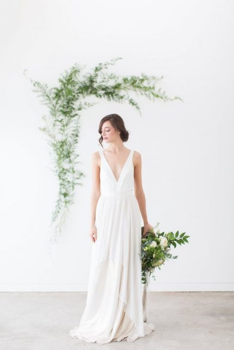 minimalist wedding gown with straps and a layered skirt