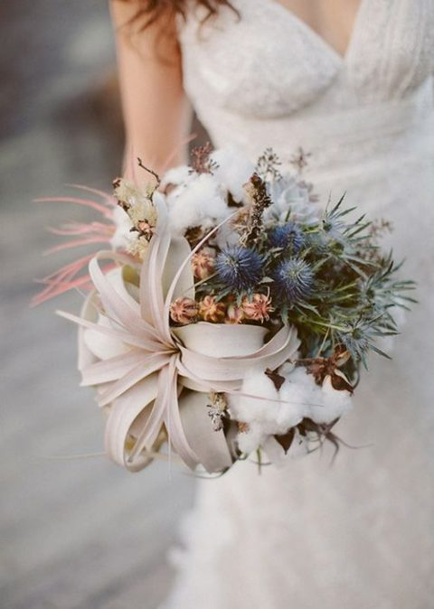 organic winter wedding bouquet with air plants_ blue thistles_ and cotton