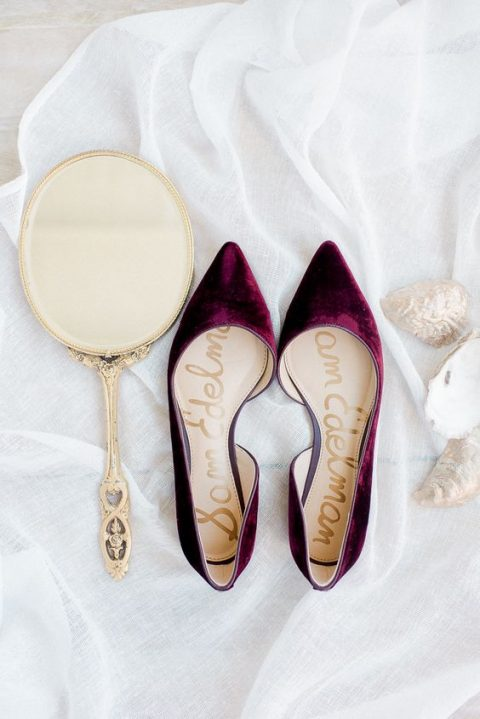 plum-colored pointed toe flats