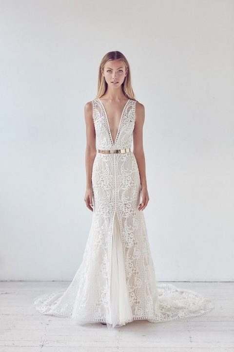 plunging neckline boho lace wedding dress with a front slit and underskirt and a metallic belt