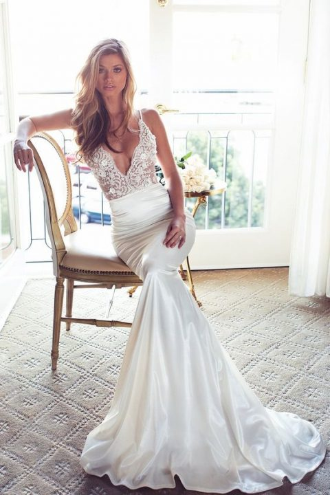 sexy mermaid wedding dress with a plain skirt and a lace bodice on straps