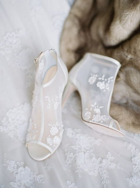 sheer white wedding booties with floral appliques and peep toes