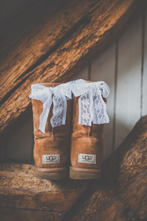 ugg boots with lace bows on the backs to feel cozy on a cold day