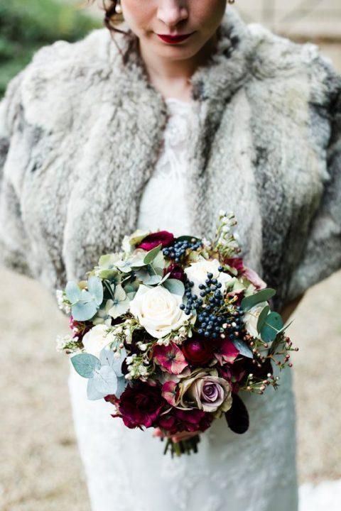white and lavender roses_ privet berries_ fuchsia blooms_ pale greenery