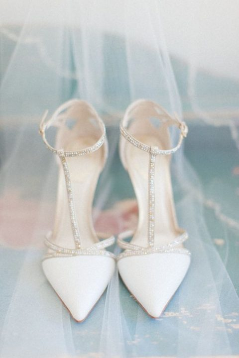 white ankle strap wedding shoes with a bling