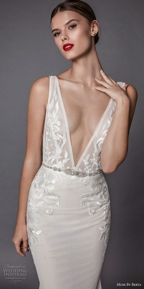 wide strap heavily embellished wedding dress with a plunging neckline