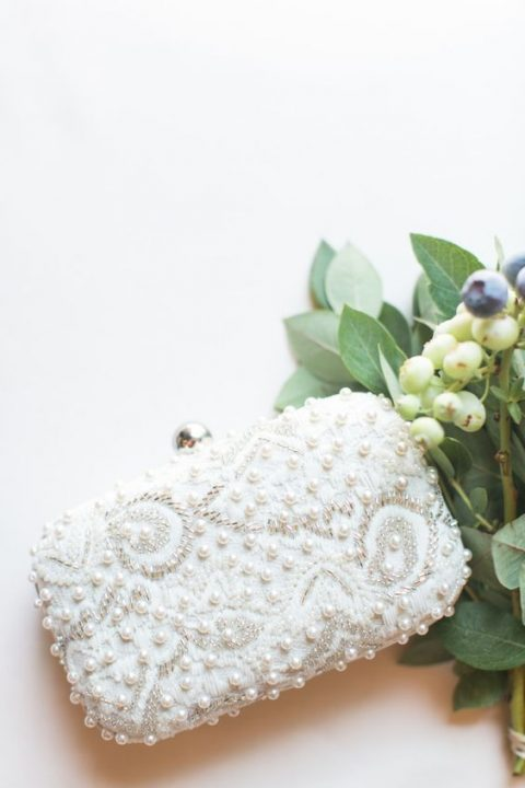 a beautiful pearly and bead embroidered clutch is classics