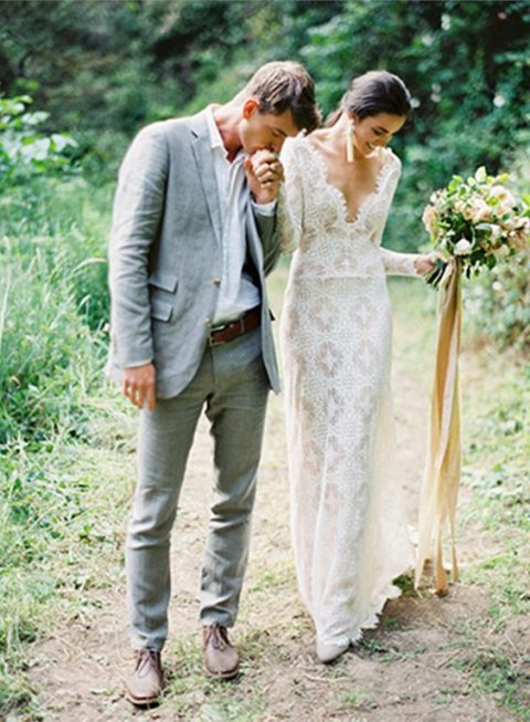 a boho lace wedding dress with a V neckline and long sleeves flatters all the curves
