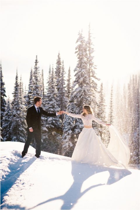 a bridal separate with a lace top with long sleeves and a full skirt with a train