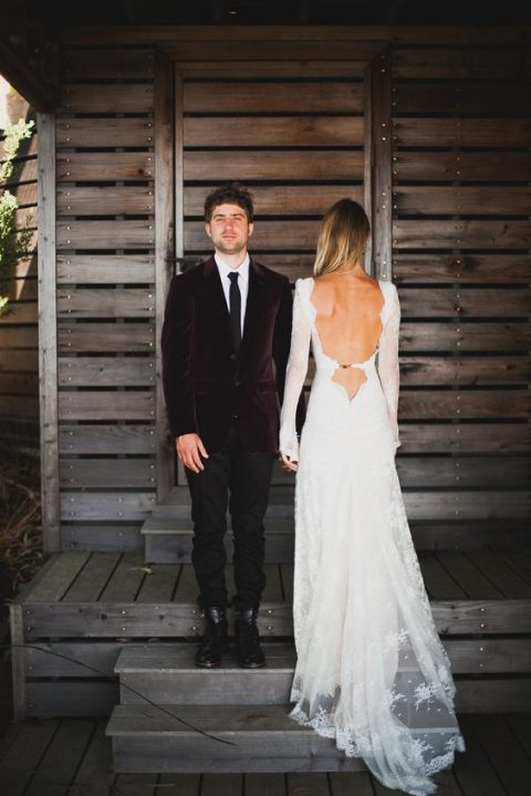 a chic lace wedding dress with long sleeves and a sexy open back