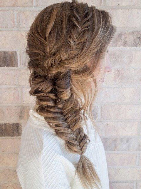 a chunky fishtail braid with soem waves down