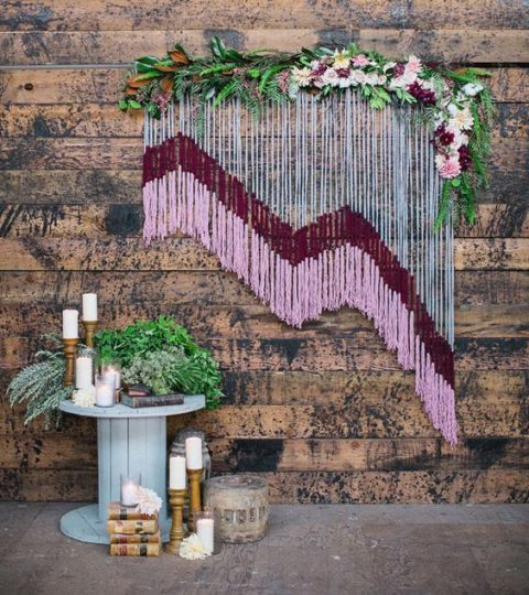 a colorful macrame_ greenery and blooms wedding backdrop