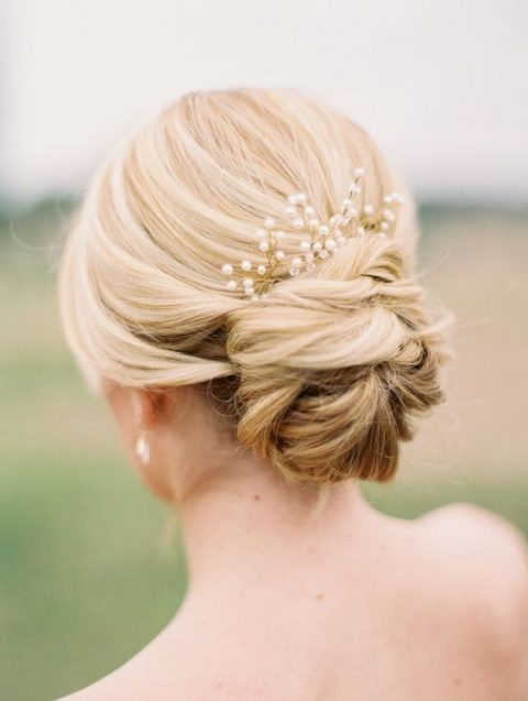 a gold pearl and bead hairpiece on a low bun