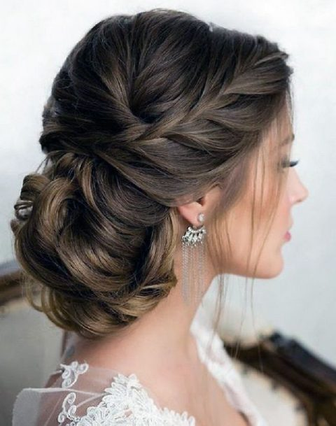 a graceful braided side updo with a low bun and locks down