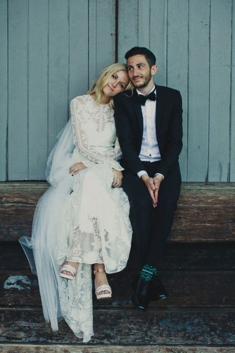 a lace long sleeve wedding dress with an illusion neckline and long sleeves