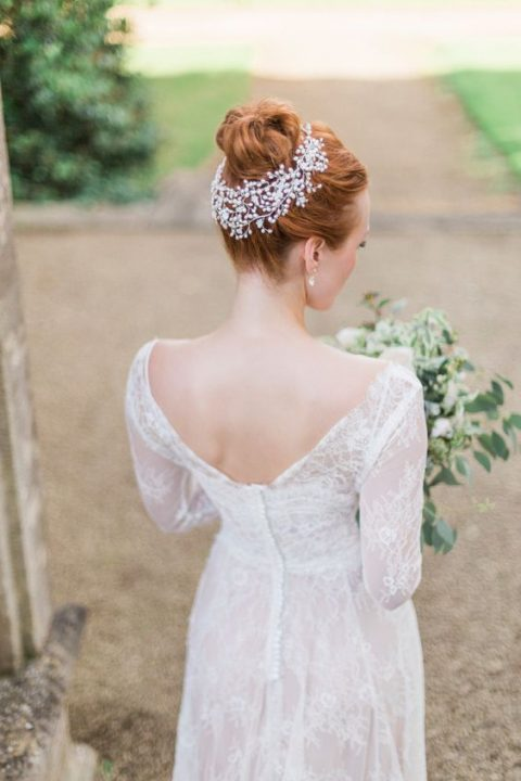 a large pearl and rhinestone headpiece to highlight the bun