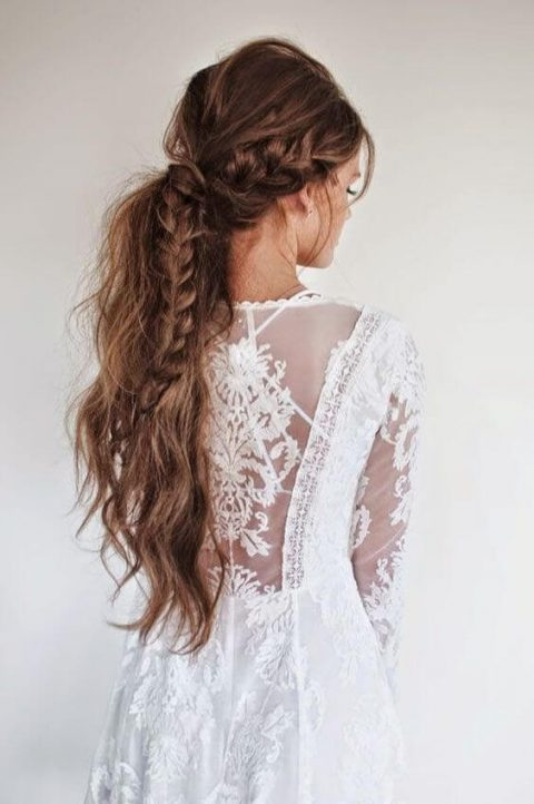a long messy ponytail with a large braid inside