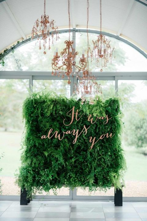a lush living greenery wall_ copper calligraphy and copper chandeliers