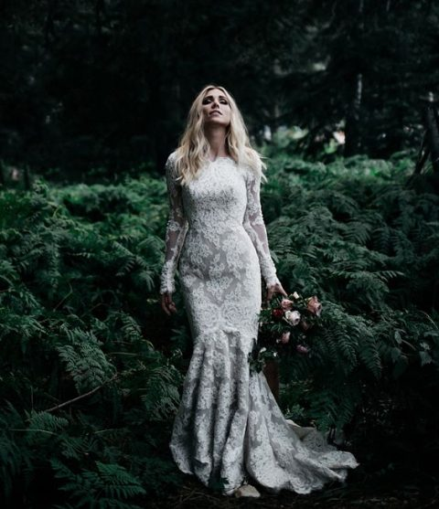 a mermaid lace wedding dress with long sleeves and a small train
