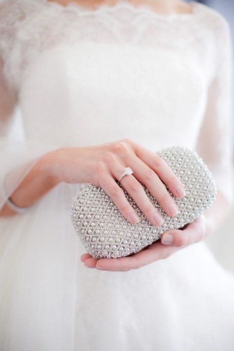 a modern small rhinestone and pearl clutch will contain everything you need