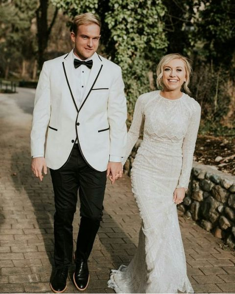 a modest wedding dress with long sleeves and a sparkle and a textural look