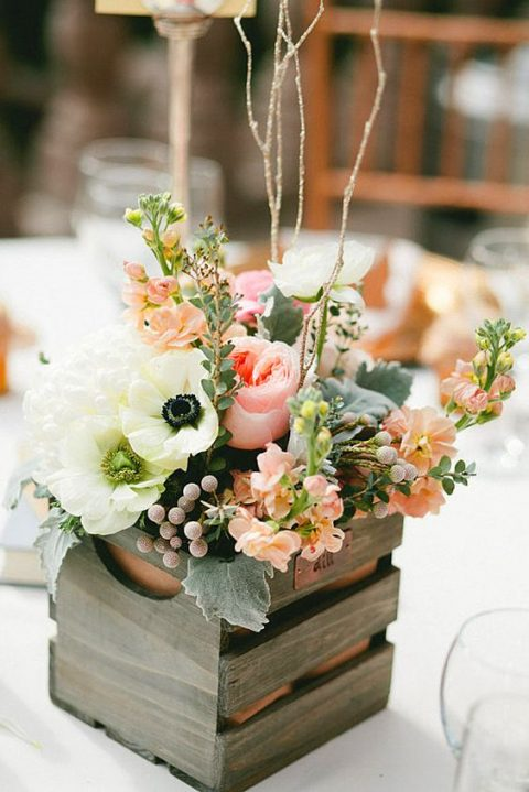 a pallet wood box with peachy and pink blooms