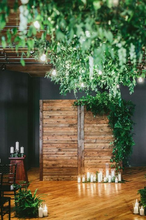 a reclaimed wood wall_ lush greenery and candles