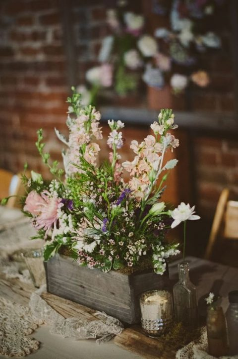 a reclaimed wooden box with wildflowers and pink blooms