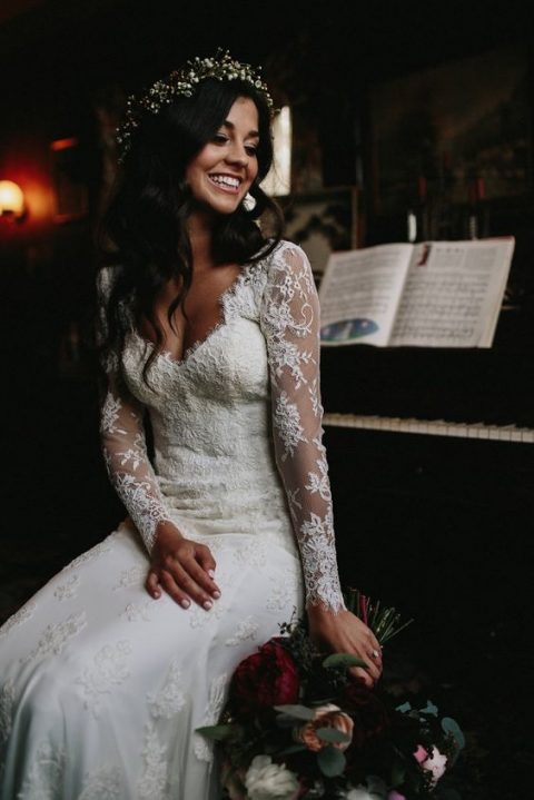 a romantic long sleeve wedding dress with lace appliques_ illusion sleeves and a flattering neckline
