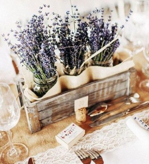 a shabby wood box with mason jars and lavender