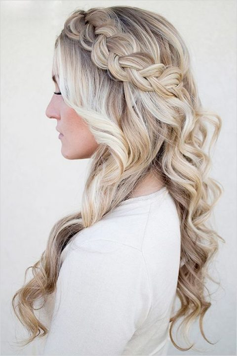 a sided braid half updo with long waves