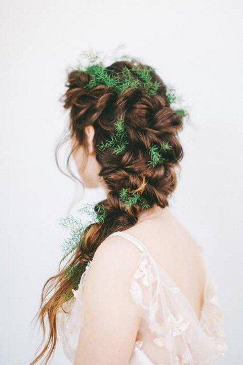 a twisted braid with greenery tucked in