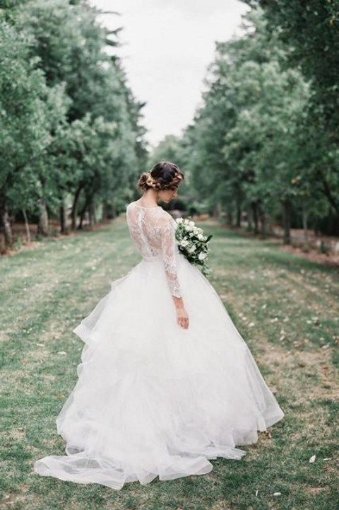 a wedding ballgown with a lace bodice and a layered skirt