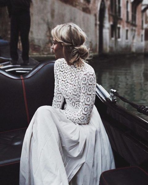 a wedding dress with a lace bodice and long sleeves_ a turtleneck and a pleated skirt