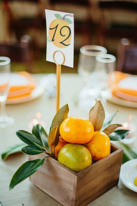 a wood box with citrus and foliage for a tropical wedding