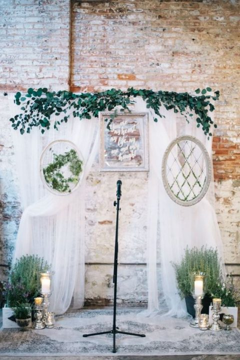 an airy fabric backdrop_ greenery embroidery hoops_ foliage and candles