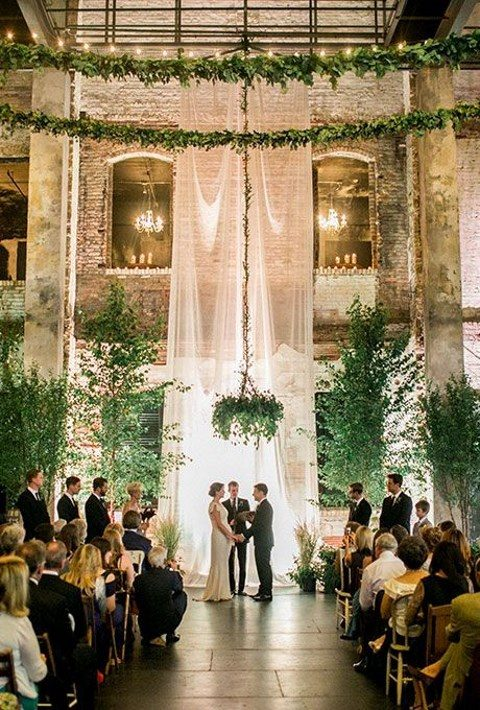 an airy fabric backdrop_ trees and a lush greenery chandelier