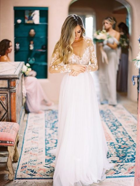 an illusion bodice and sleeve wedding dress with a layered tulle skirt