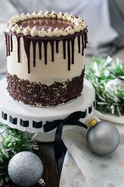 chocolate eggnogg wedding cake with marshmallows on top and chocolate drip