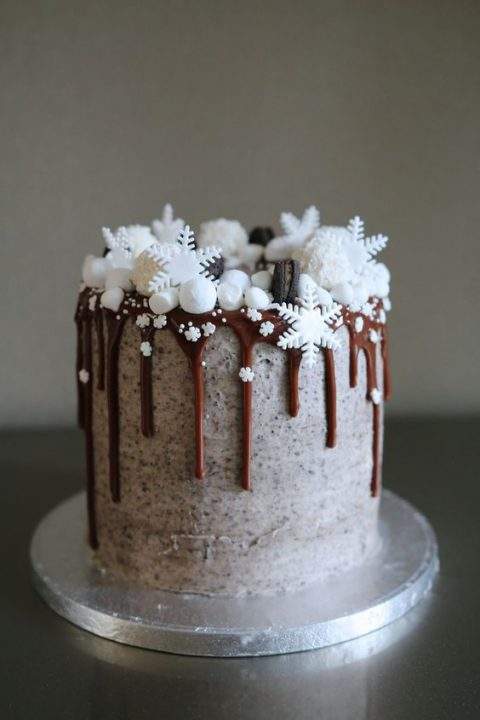 chocolate frosted wedding cake with caramel drip_ Oreos_ marshmallows and snowflakes