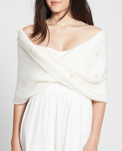 cozy warm coverup with large pearls for a winter bride