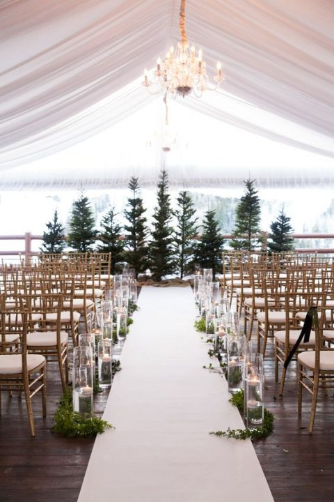 evergreen trees_ floatign candles and greenery for a winter wedding