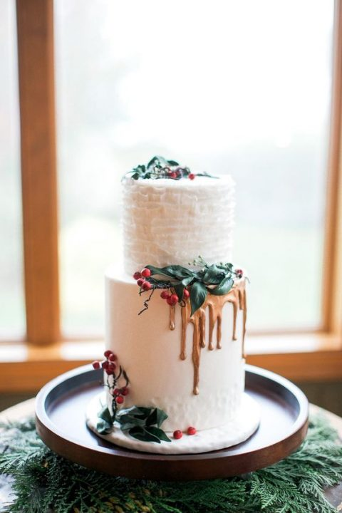 frosted wedding cake with a ruffled layer_ gold drip and mistletoe