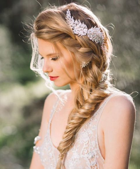 one side fishtail braid with a rhinestone headpiece and matching earrings
