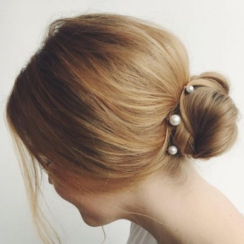 pearl pins to highlight a messy low bun