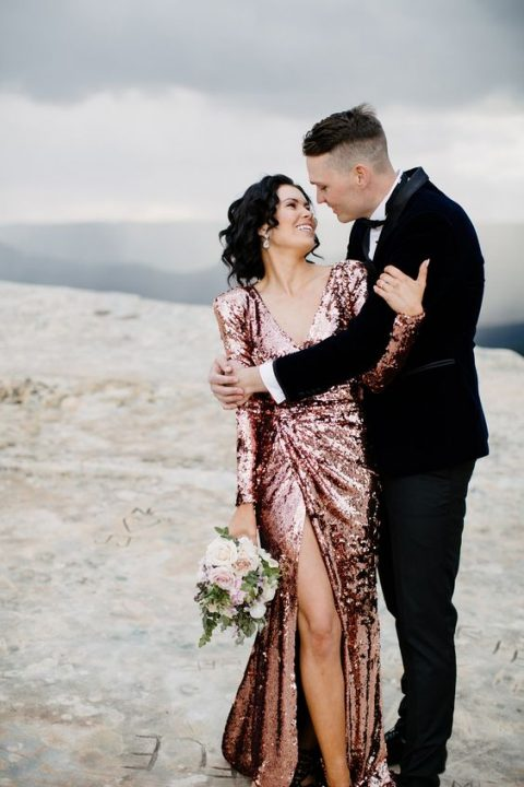 pink sequin long sleeve wedding dress with a V neckline and a front slit