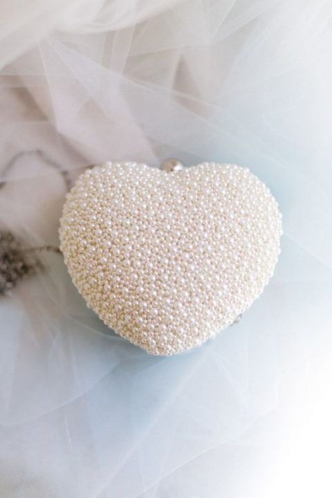 romantic brides can opt for heart-shaped clutches